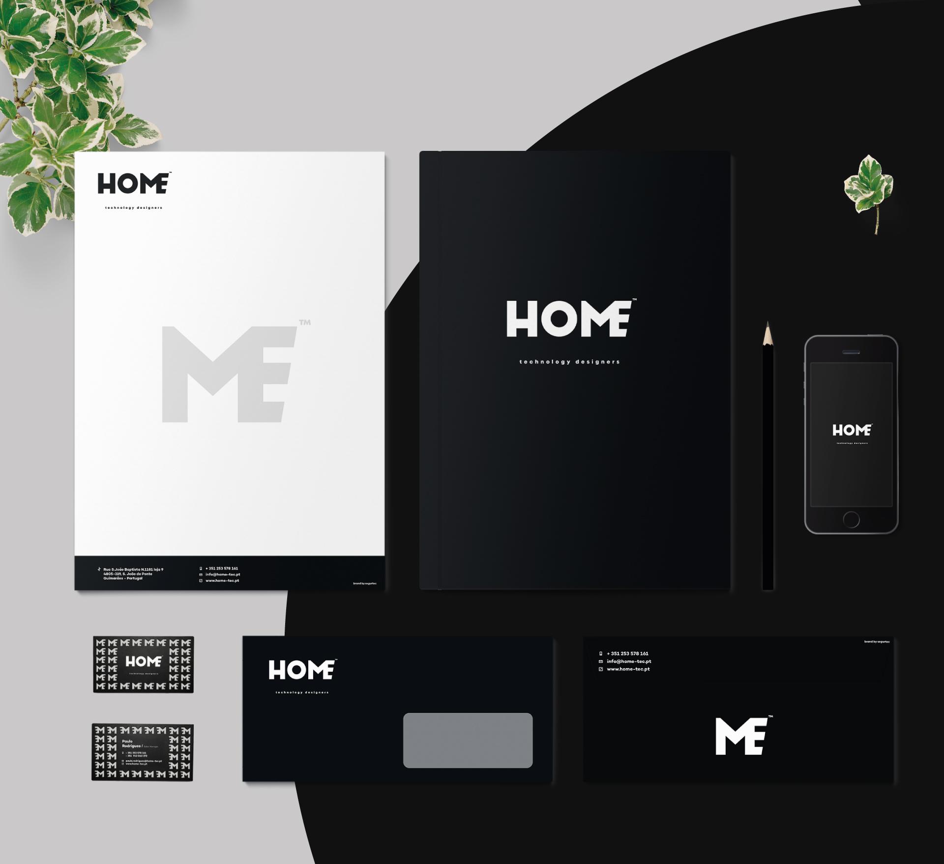 Exemplos de aplicações da marca Home em envelopes, capas, papel timbrado e cartões